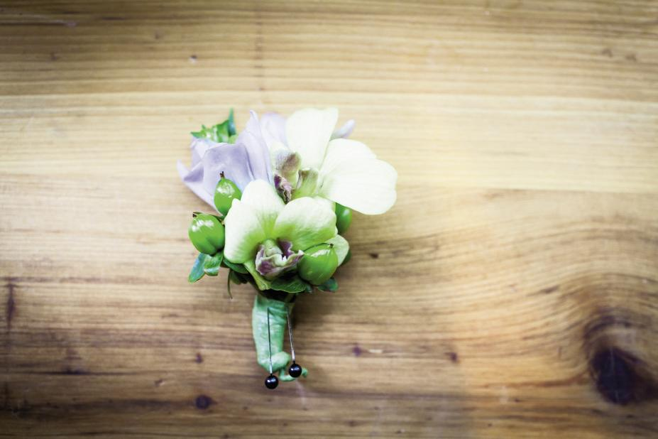 BADGE OF HONOR: Groomsmen  sported boutonnieres of orchids and green hypericum berries by OK Florist.