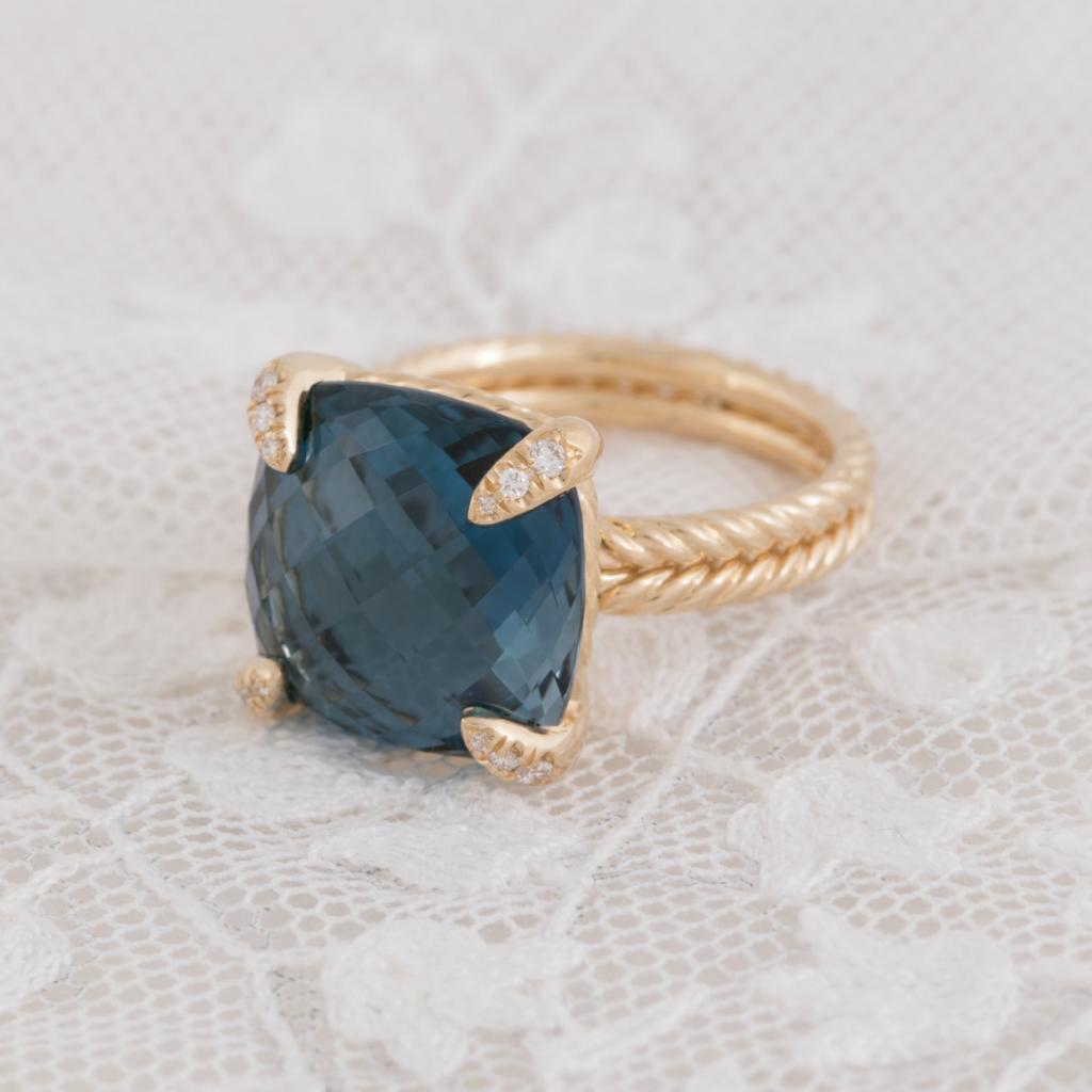 David Yurman's 18K gold, blue topaz, and diamond ring from REEDS Jewelers ($1,850).