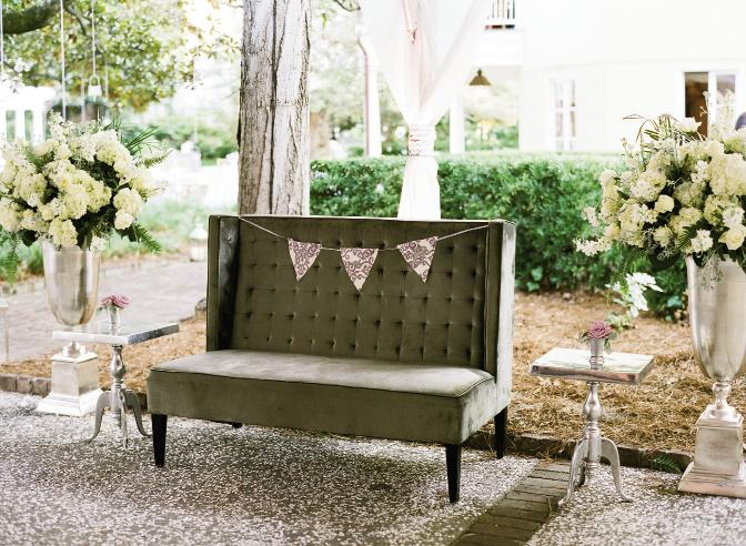 REST STOP: Melissa added whimsy (and color) to a pewter settee with pennants in the day's signature violet damask print. Oversized silver vases were resplendent with masses of off-white blooms.