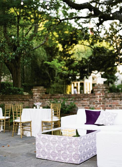 "SWEET MEMORIES: ""We kept the furniture white and added rich color via throw pillows,"" explains planner Melissa Barton. ""Knowing us,"" says bride Christine, ""there will now be purple cushions in our flat in London."" A Greenville, South Carolina, native, she met Boris, a Bulgarian, when he was at Furman University."