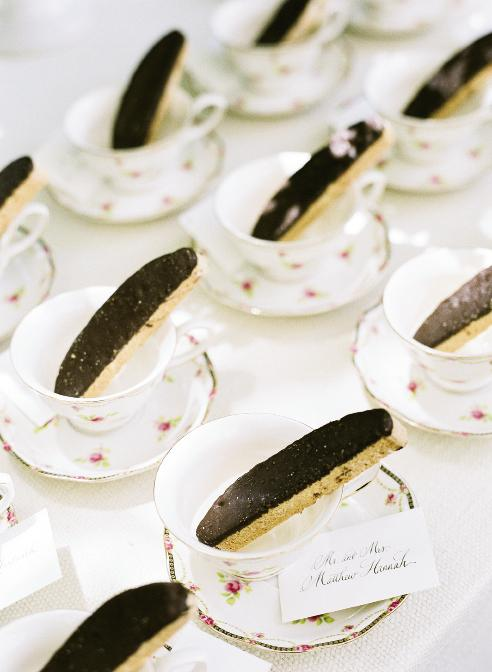 TAKE A DIP: Liz has a sweet tooth, so the coffee and tea bar featured treats like chocolate-dipped biscotti presented on English rose-patterned teacups, which also served as favors. Guests' table numbers were written in calligraphy on cards tucked under the cups.