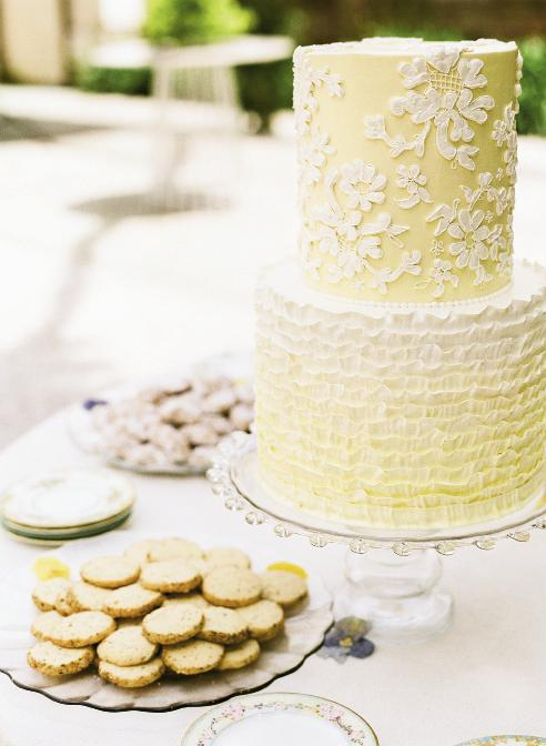 SWEET TREATS: Wedding Cakes by Jim Smeal took inspiration from the lace on Liz's wedding dress for the cake, which featured lemon and coconut flavors, plus a top tier of chocolate hazelnut for the couple to save for their first anniversary.