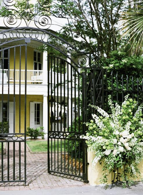GREEN GREETINGS: In an unusual twist for the stalwart Charleston wedding location, Gathering Events placed enormous, springy arrangements outside the William Aiken gates, a treat for all Sunday passersby.