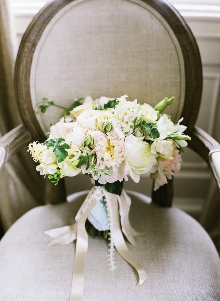 HANDLE WITH CARE: The bride carried an English-inspired bouquet of white,  pale yellow, and candy-floss  pink freesia, with garden  roses, hyacinth, lisianthus,  peonies, ranunculus, scabiosa, and scented geranium.