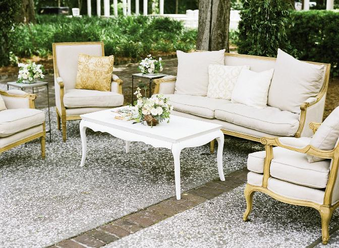 REST EASY: Plush upholstered chairs and settees created conversation nooks throughout the grounds.