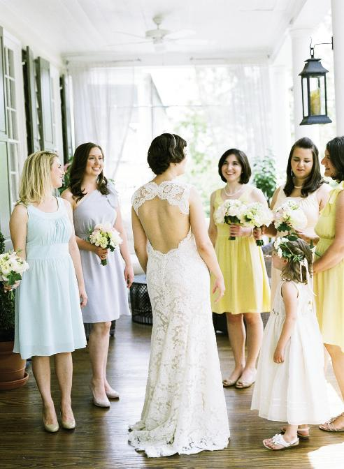 "EASTER PARADE: Liz wore Monique Lhuillier from Maddison Row, while her bridesmaids slipped into dresses from LulaKate's matte silk collection. ""We went with short dresses,"" says Liz, ""for comfort because of the time of year and because it made everything feel fun and a little less formal."""