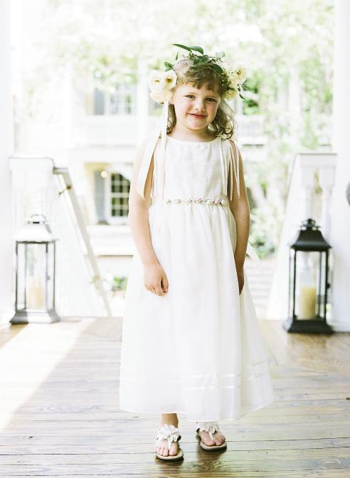 HATS OFF: Liz's niece, Cate, happily donned a crown for her duties as flower girl.