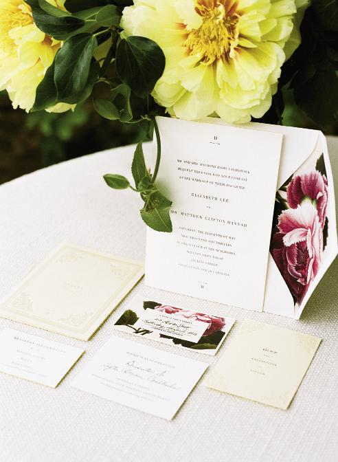 DOWN THE GARDEN PATH: Save-the-date cards from Sideshow Press featured pressed flowers, so the stationery suite included a floral theme, too.