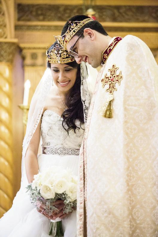 PRECIOUS METALS: Christine's Lazaro gown featured silver detailing, while Boris' ceremonial robe boasted a gilded cross.