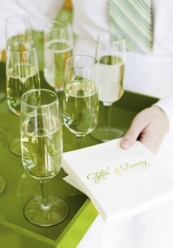 "THIRST QUENCHER: Guests were offered champagne with ""Tyler & Danny"" cocktail napkins."