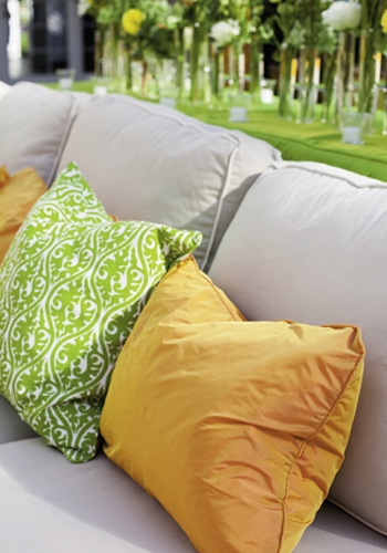 SPRING THING: Custom pillows added comfy pops of color to the setting.