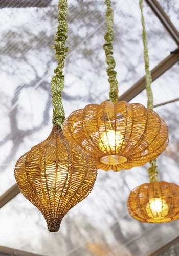 HANGING AROUND: Woven lanterns with custom cord covers added an organic element.