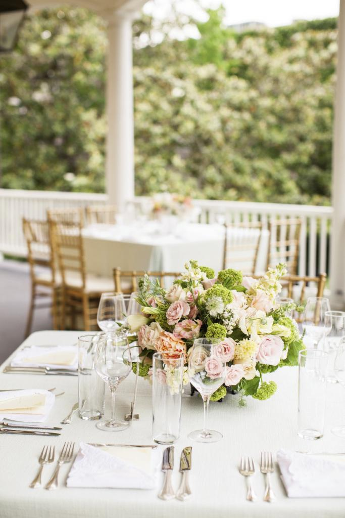 CENTER OF ATTENTION: Combinations of pastel-colored double tulips, dusty  miller, eucharis lilies, peonies, scented geranium, and spray roses topped each table.