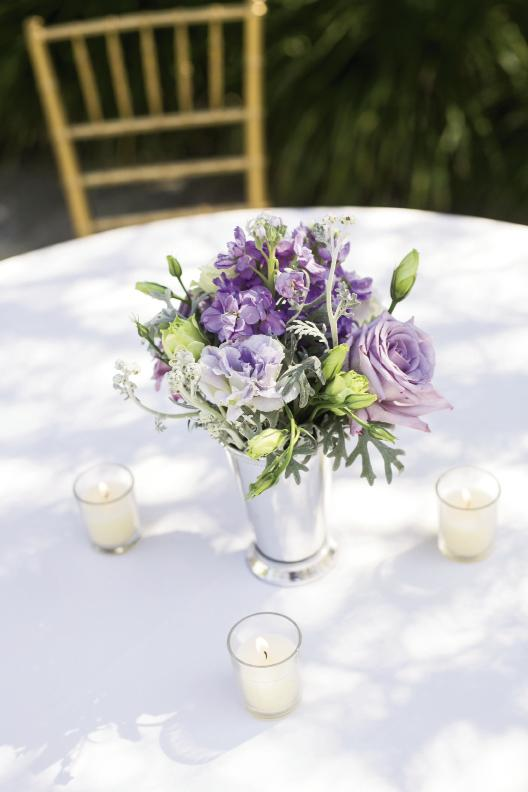 Jonie of A Charleston Bride potted lisianthus and ranunculus in varying shades, from eggplant to pale lilac.