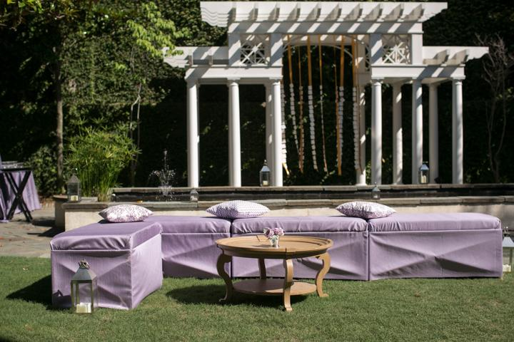 IN N' OUT: The elegance of the house's interior easily transferred to the garden with lavender sateen bench ottomans, antique furniture, and escort-card laden streamers swinging from the palatial white arbor.