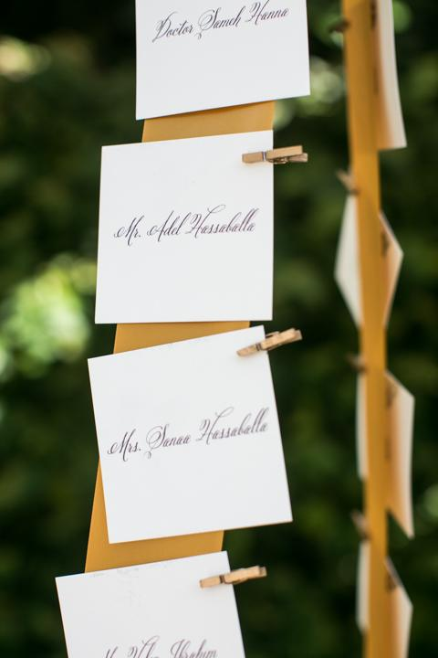 PICK ONE: Melissa Barton of A Charleston Bride affixed escort cards to golden strips of fabric with tiny gilded clothespins.