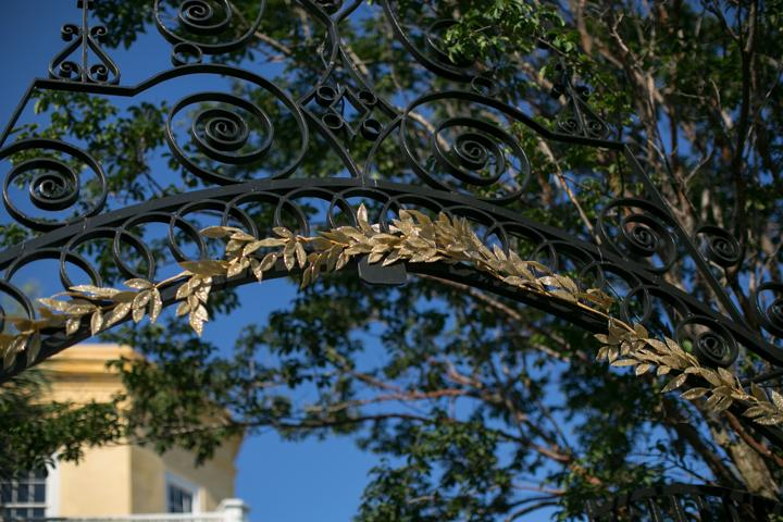 LEAVES OF GRASS: Golden fronds woven into the house's wrought iron gates beckoned guests to enter.