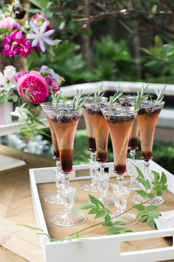 "Greet guests with colorful, seasonal cocktails, like this berry and herb spritzer. ""There's nothing more festive or special than a ladylike cocktail crafted just for the occasion,"" says Calder. ""It says 'I spent time on you' and 'J'adore.'""  <i>Photograph by Gayle Brooker</i>"