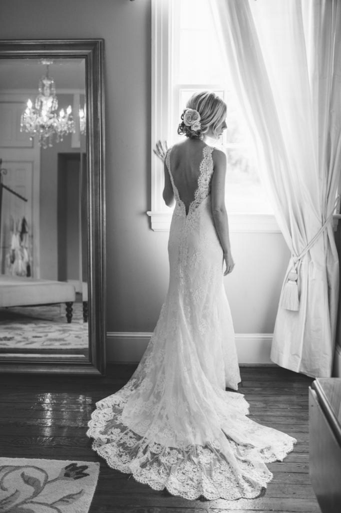 Bride's gown by Marisa Bridals. Hair by Paper Dolls. Photograph by Juliet Elizabeth at the Legare Waring House.