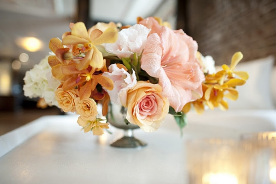 PRETTY IN PEACH: Amaryllis, lisianthus, and parrot tulips added pops of peach and orange to the reception décor.