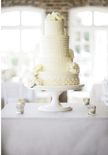 IVORY TOWER: The four-tiered confection by Wedding Cakes by Jim Smeal mimicked the tablescape's white and cream coloring, the layers of Aly's Vera Wang gown, and the flora of her bouquet.