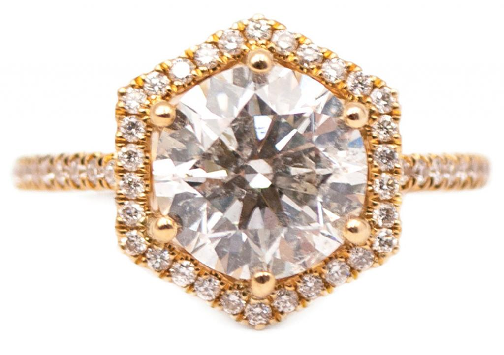 2.51 ct. round brilliantcut diamond set in 14K gold with diamondstudded (.30 total cts.) hexagonal halo and band from Sandler's Diamonds & Time ($24,898)