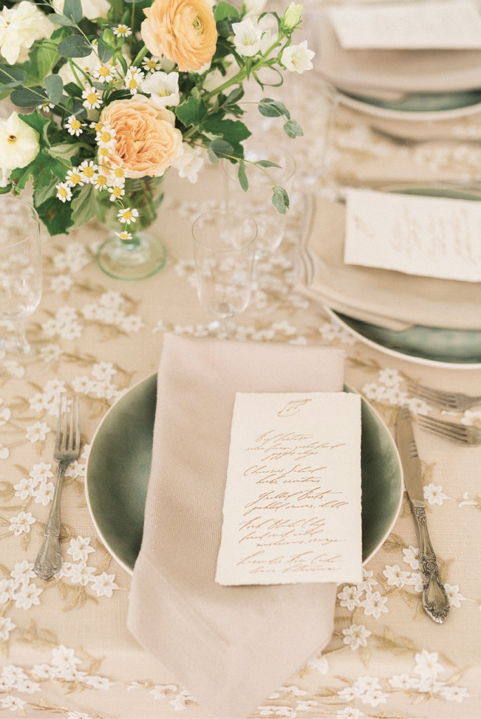 Prairie & Sage designed the wedding suite. For a unique textural element, they incorporated bark paper, while botanical stamps added a natural touch.