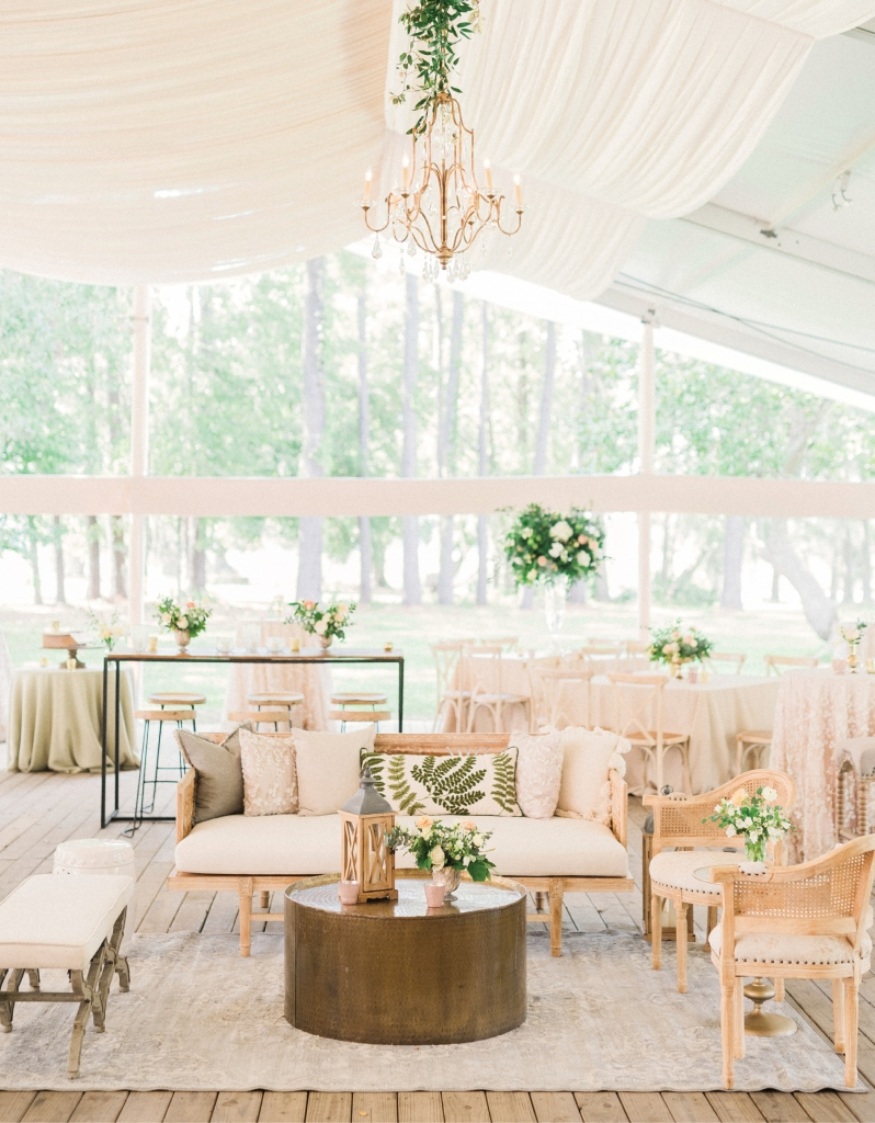 The bride envisioned a semi-rustic wedding with natural accents, greenery and bright florals, romantic lighting, and a touch of glamour. Working with a neutral color palette, planner Haley Kelly leaned heavily on texture, mixing linens and other fabrics to create a look that's refined yet relaxed.