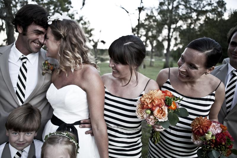 SUIT YOUR FANCY: Ashley says that as a designer, she is inspired by bold graphics, so it's fitting that she chose these back and white striped bridesmaids dresses.