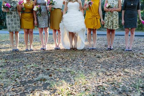 "FANCY FROCKS: ""I knew that I wanted all of the girls in different dresses,"" says Sarah, ""and didn't think varying styles in the same fabric was going to satisfy my obsession with textures."" So she hopped online and found an individual gown in singular fabrics for each bridesmaid."