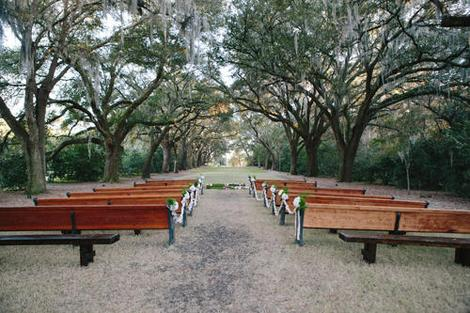 HALLOWED GROUND: Rows of pews transformed the oak allée at the Legare Waring House into a cathedral-like setting for the ceremony.