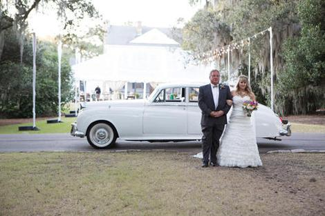 SWEET RIDE: Sarah and her father stepped out of Limos for Less' 1957 Bentley and then walked down the aisle.
