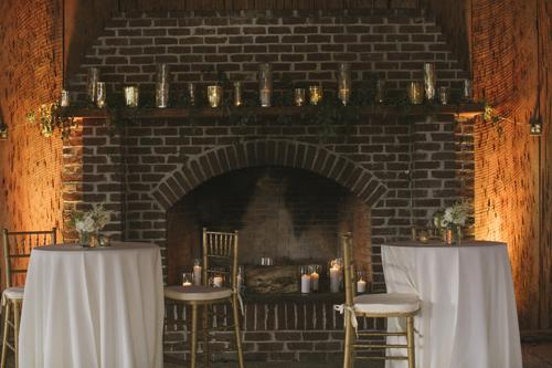 GILDED EDGE: Use mercury glass vases and votive holders in different sizes to add elegance to a rustic location.