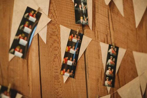 MEMORY LANE: To make guests truly feel a part of the day, incorporate photo strips from one of the parties leading up the wedding—or from the wedding itself if you hire a photo booth.
