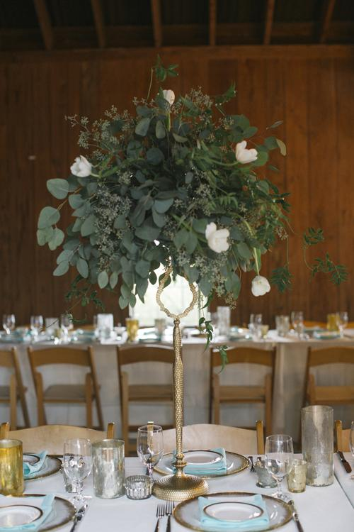 METAL HEAD: Gilded accents outlined shapes and emphasized texture to make the tablescapes dynamic. For proof, see the hammered finish candelabras (topped with greens and blooms) and gold-tipped plates.
