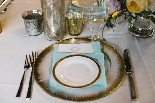 IN THE THEME: The bride dubbed the evening's main hue 'Antique Turquoise.' Sara Hosch of Southern Protocol incorporated the color throughout the design, like with these napkins paired with the gold-rimmed reception china.