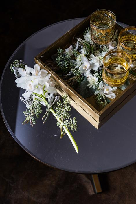TRAY BIEN: Give some life to a serving tray when you deconstruct boutonnieres or bouquets post-ceremony and tuck them under lucite.
