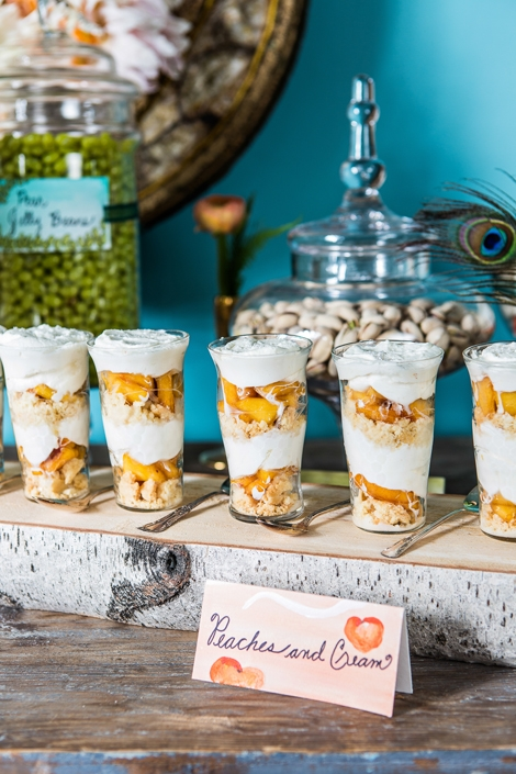 PARFAIT PALETTE: Desserts like these peach parfaits were chosen for the way the color complements the turquoise backdrop and picks up the pinks in the flowers. Artist Kristin Solecki's sweet and playful sign sports a few of the plump fruits.
