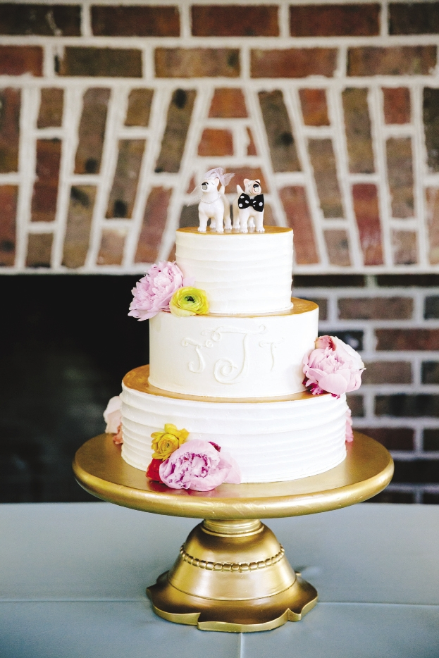 PUPPY LOVE: The Cake Stand painted cake tier tops in gold, then capped everything off with bull-terrier salt and pepper shakers Jennifer had dressed up as an ode to the couple's dog.
