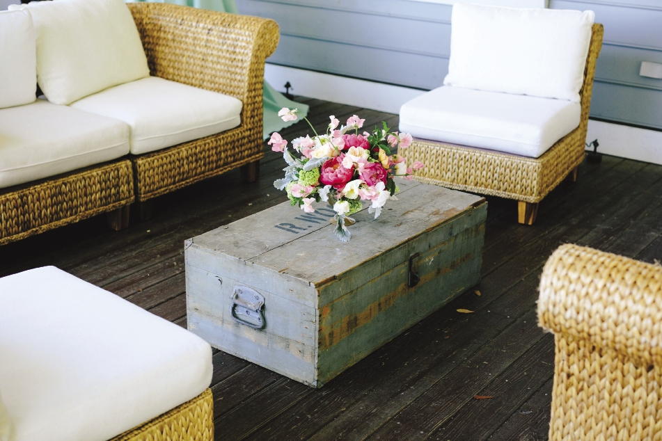 DOUBLE DUTY: A lovingly worn turquoise antique trunk from 428 Main Vintage Rentals served as a coffee table.