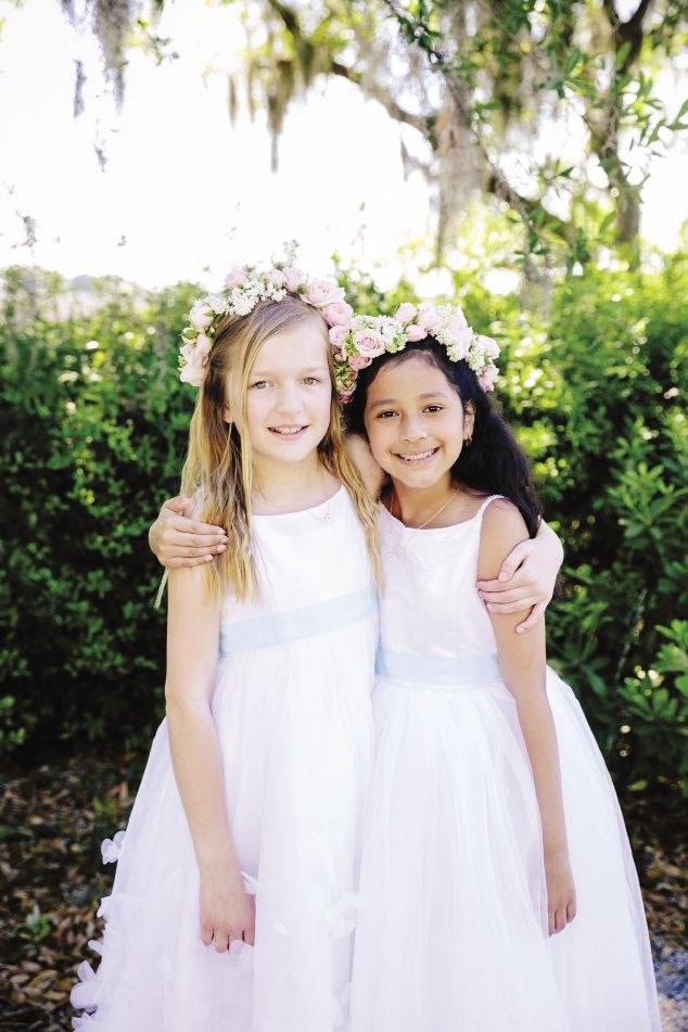 GRINNING GALS: Floral crowns from Branch Design Studio added color to the flower girls' angelic ensembles
