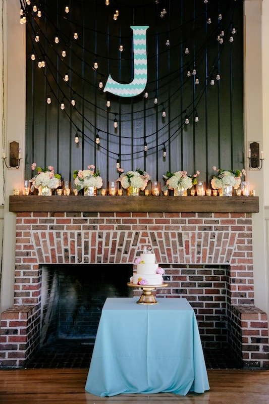 Wedding design by Southern Protocol. Lighting by Innovative Event Services. Florals by Branch Design Studio. Cake by The Cake Stand. Image by Dana Cubbage Weddings at Creek Club at I'On.
