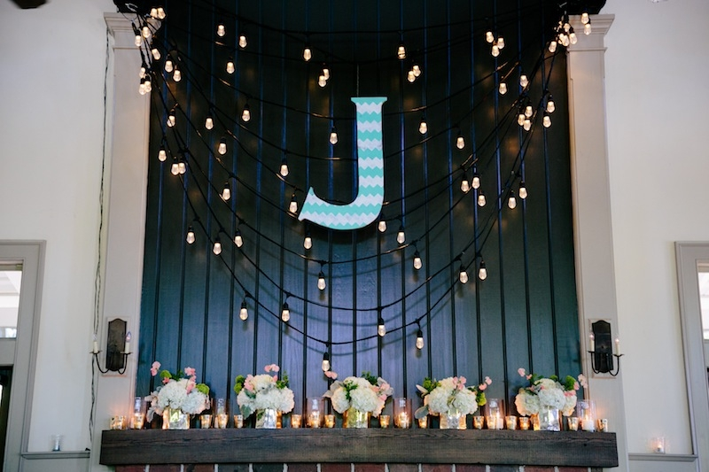 Wedding design by Southern Protocol. Lighting by Innovative Event Services. Florals by Branch Design Studio. Image by Dana Cubbage Weddings at Creek Club at I'On.