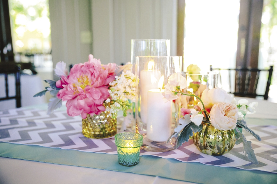 SMART TOUCH: Gray chevron runners from EventWorks added a crisp pattern to reception tablescapes.
