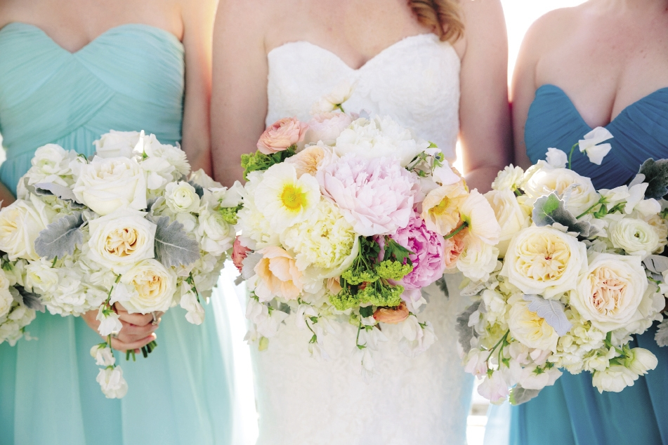 STANDOUT: Pastel flowers popped against the bride's Mori Lee gown from Jean's Bridal, while muted bouquets complemented her attendants' Donna Morgan frocks from Bella Bridesmaids.