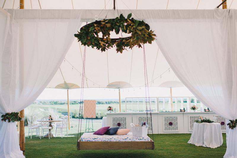 Wedding and floral design by A Charleston Bride. Bed swing from Ooh! Events. Custom fabrics designed by Blue Glass Design. Photograph by Sean Money & Elizabeth Fay at the Ocean Course at Kiawah Island.