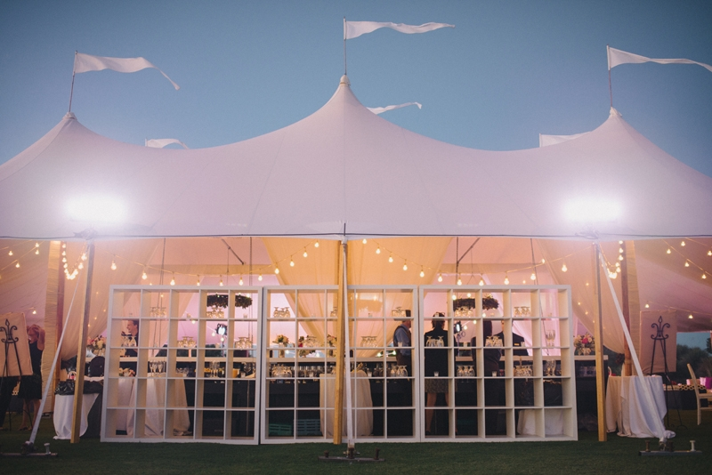 Wedding design by A Charleston Bride. Tent by Sperry Tents Southeast. Lighting and tent structure by Technical Event Company. Photograph by Sean Money & Elizabeth Fay at the Ocean Course at Kiawah Island.