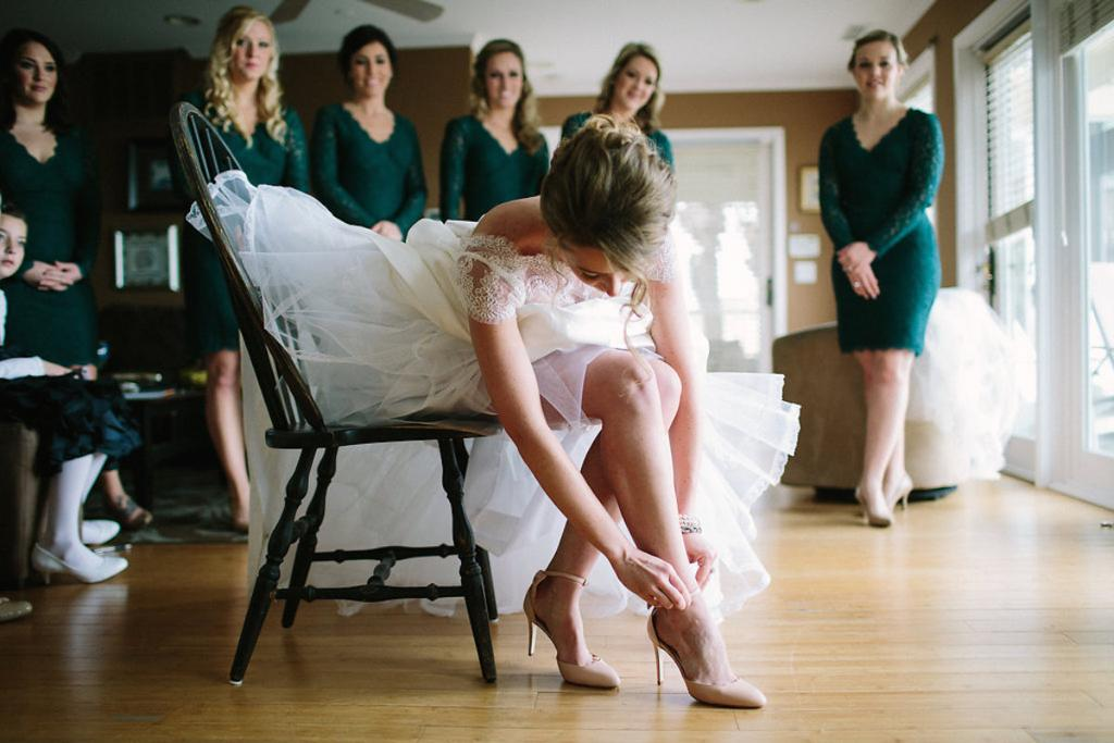 Bride's gown by Tara Keely. Bridesmaids' dresses by Adrianna Papell (available locally at Bella Bridesmaids). Hair by Krystal Yangco. Shoes by J. Crew. Image by Julia Wade Photography.