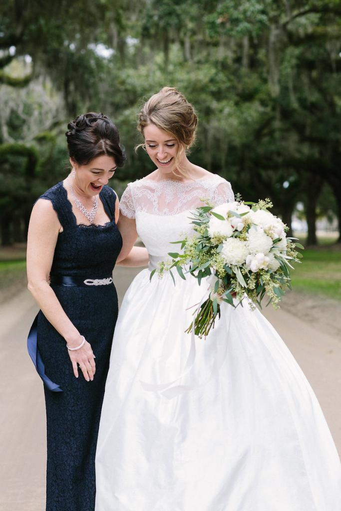 Bride's gown by Tara Keely. Bridesmaids' dresses by Adrianna Papell (available locally at Bella Bridesmaids). Florals by Lauren Luecke. Hair by Krystal Yangco. Image by Julia Wade Photography at Boone Hall Plantation.