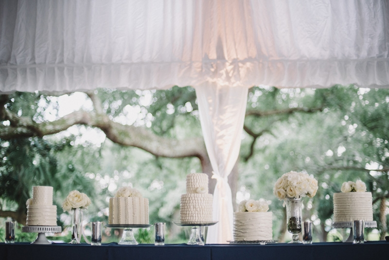 Wedding cakes by Fish Restaurant. Florals by Tiger Lily Weddings. Wedding design and coordination by Lindsey Shanks of A Charleston Bride. Photograph by Sean Money + Elizabeth Fay at Lowndes Grove Plantation.